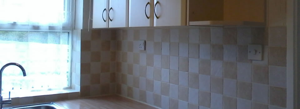 Kitchen unit fitting and tiling